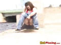 Peeing next to water