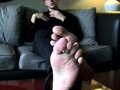 Amateur hunk rubbing on his feet on the couch